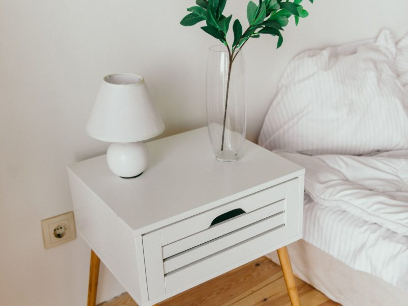 white-table-lamp-on-top-of-nightstand-2082092